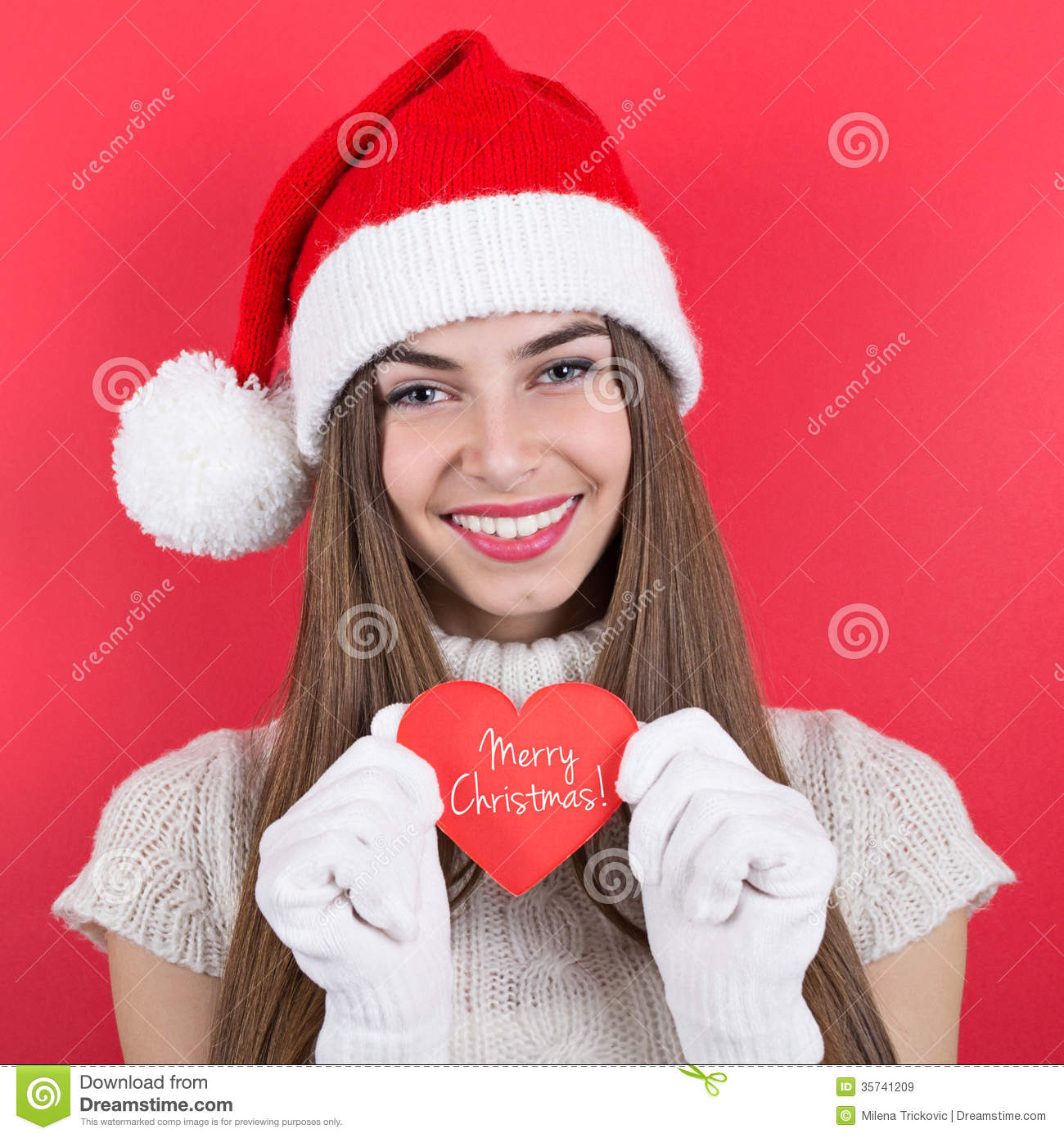 Happy Teen Girl With Santa Hat Showing Message Merry