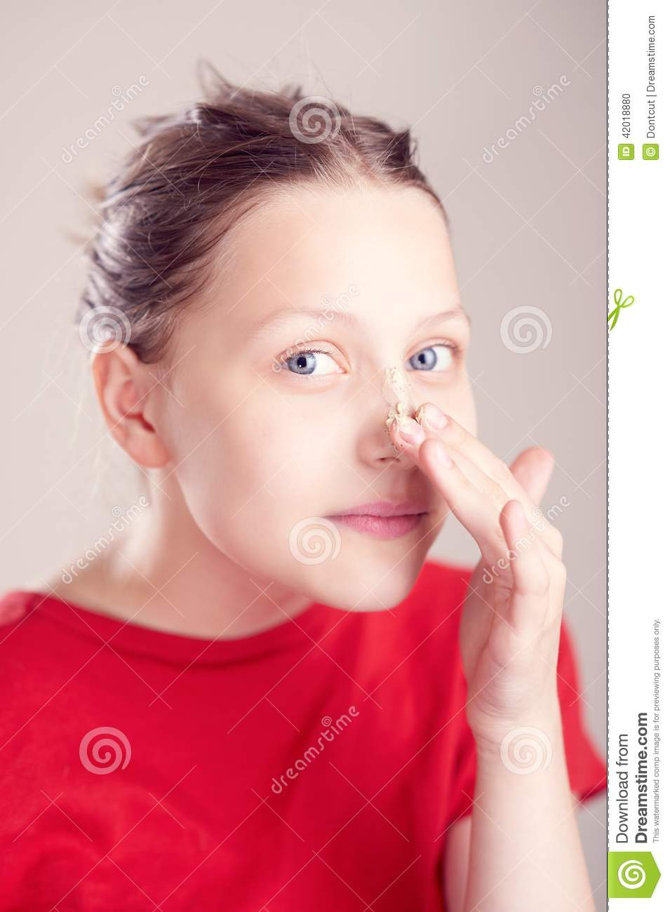Happy Teen By Crumbling Wall Stock Image: Happy Teen Girl With Scrub Mask On Her Face Stock Photo