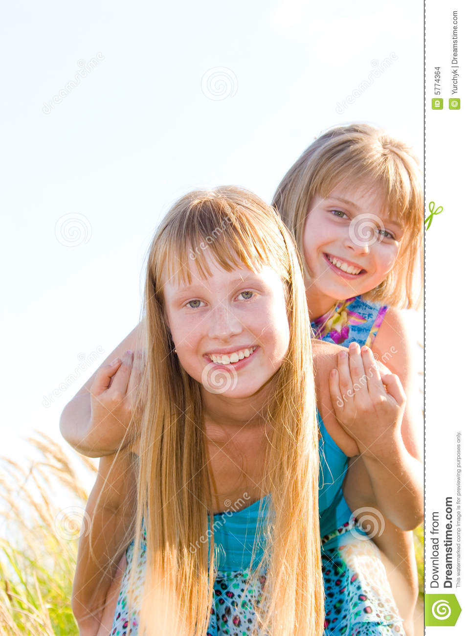 Happy Teen By Crumbling Wall Stock Image: Happy Teen Sisters Stock Images