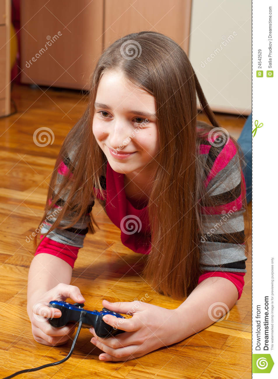 happy teenage girl playing computer games royalty free