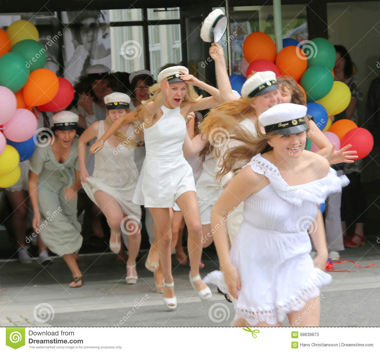 Happy teenage girls running out from school after graduation