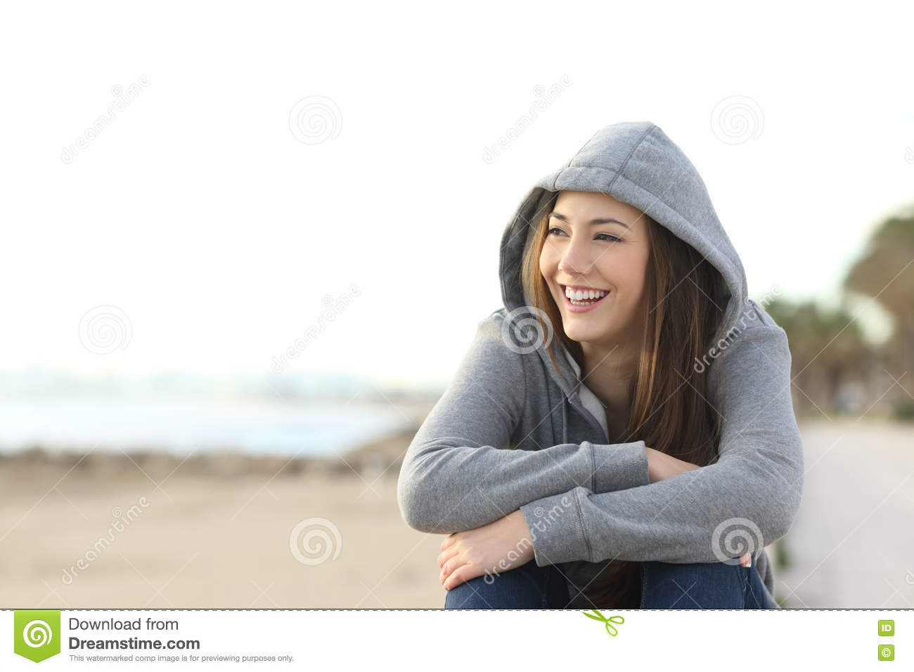 Happy teenager girl looking at side outdoors