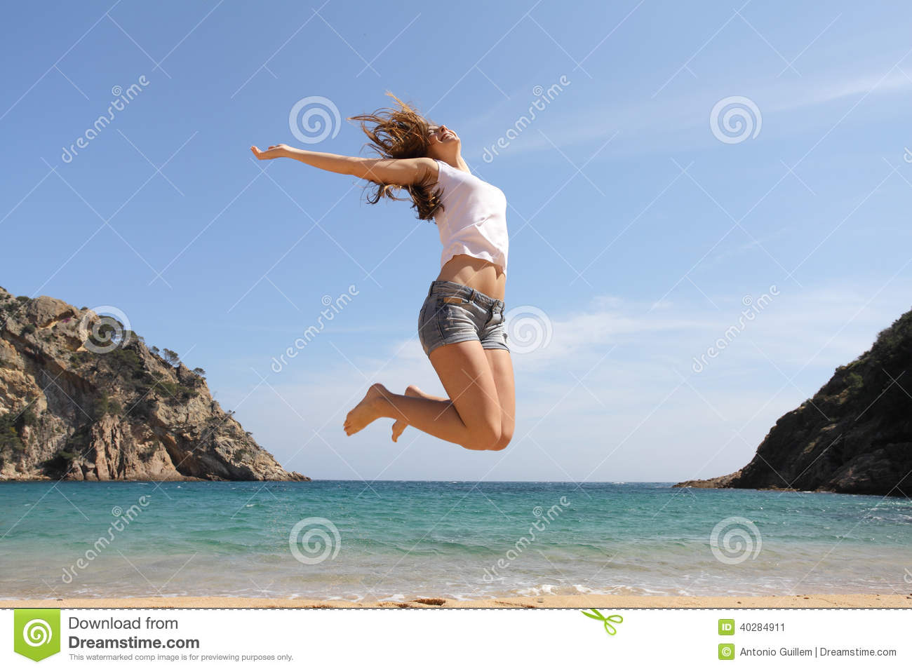 Happy teenager jumping on the beach