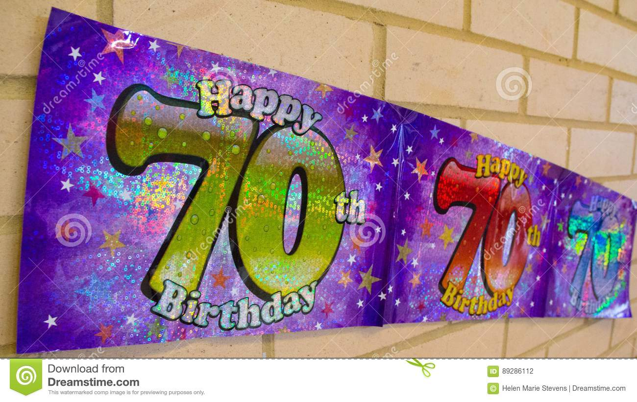 happy 70th birthday banner on wall stock photo  image: 89286112