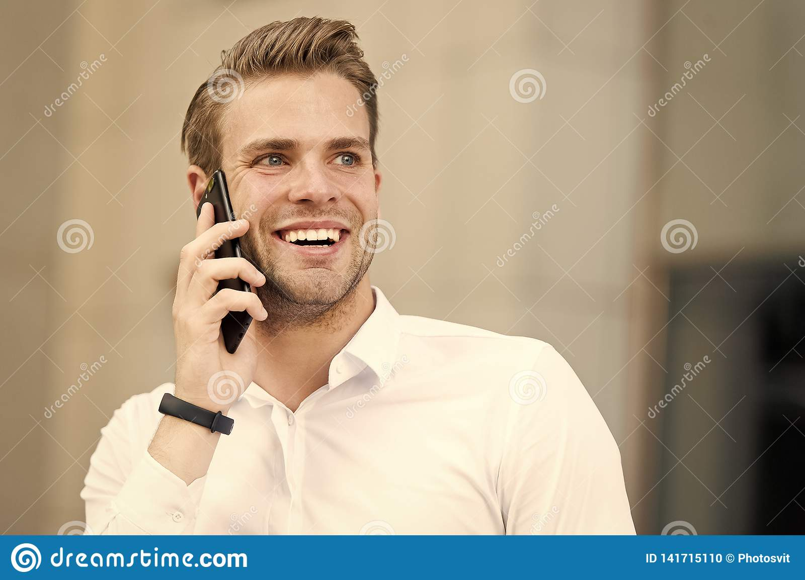 Happy to hear you. Man well groomed speak mobile phone urban background. Businessman cheerful call friend. Friendly