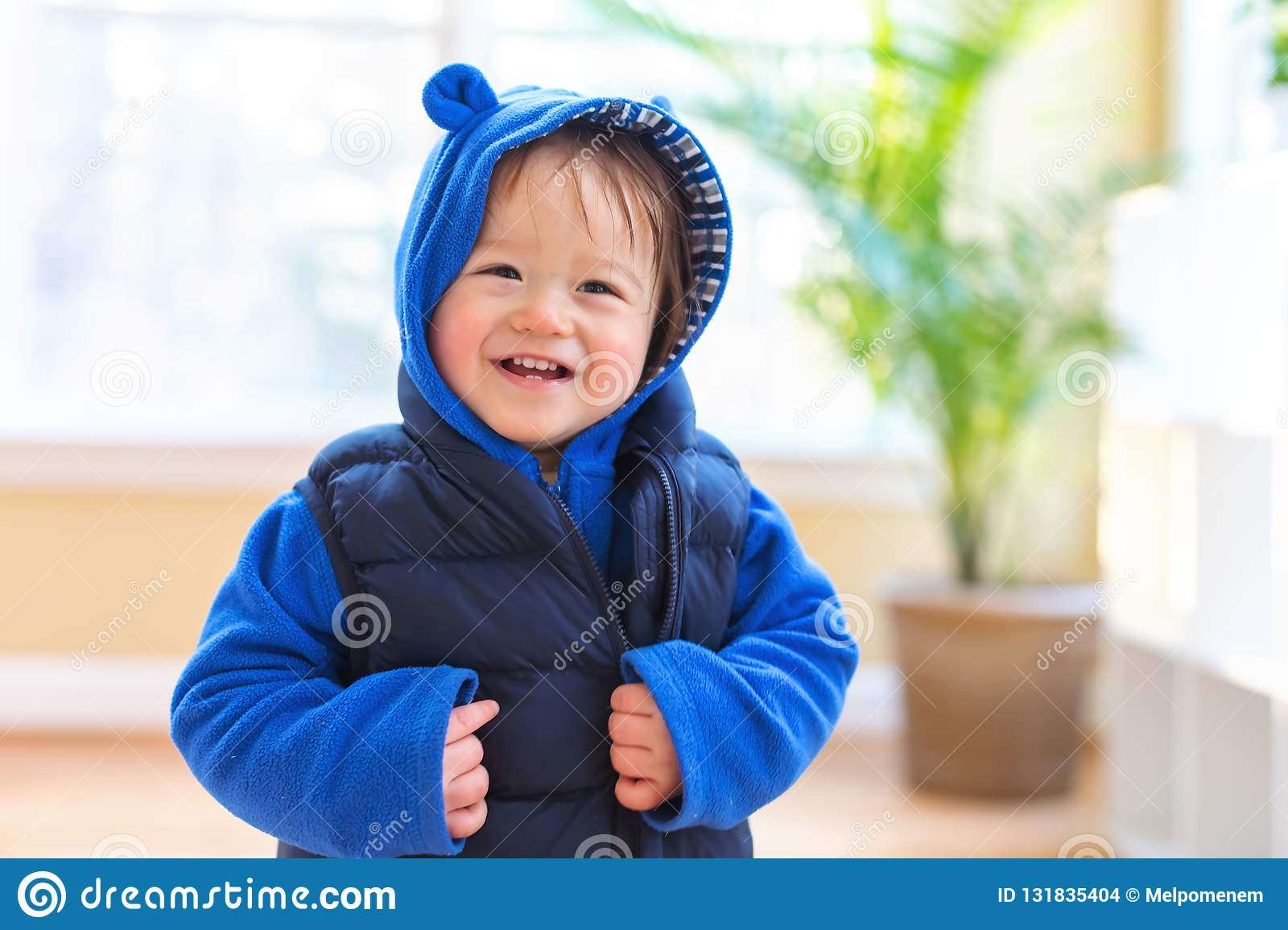 Happy toddler boy bundled up in winter clothes
