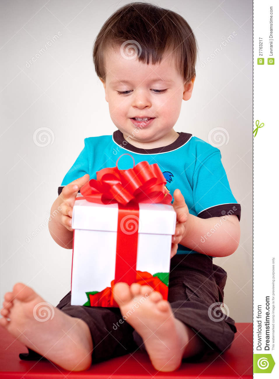 Happy Toddler Boy Opening A Gift Box Royalty Free Stock