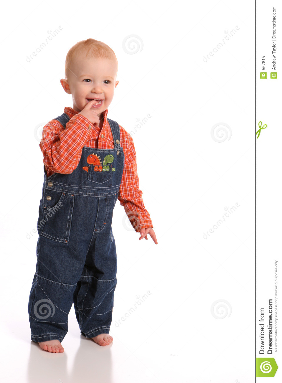 Happy toddler in overalls