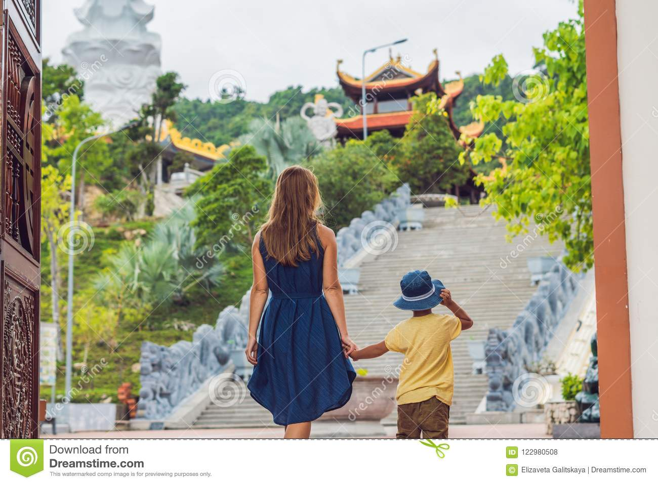 Happy tourists mom and son in Pagoda. Travel to Asia concept. Tr