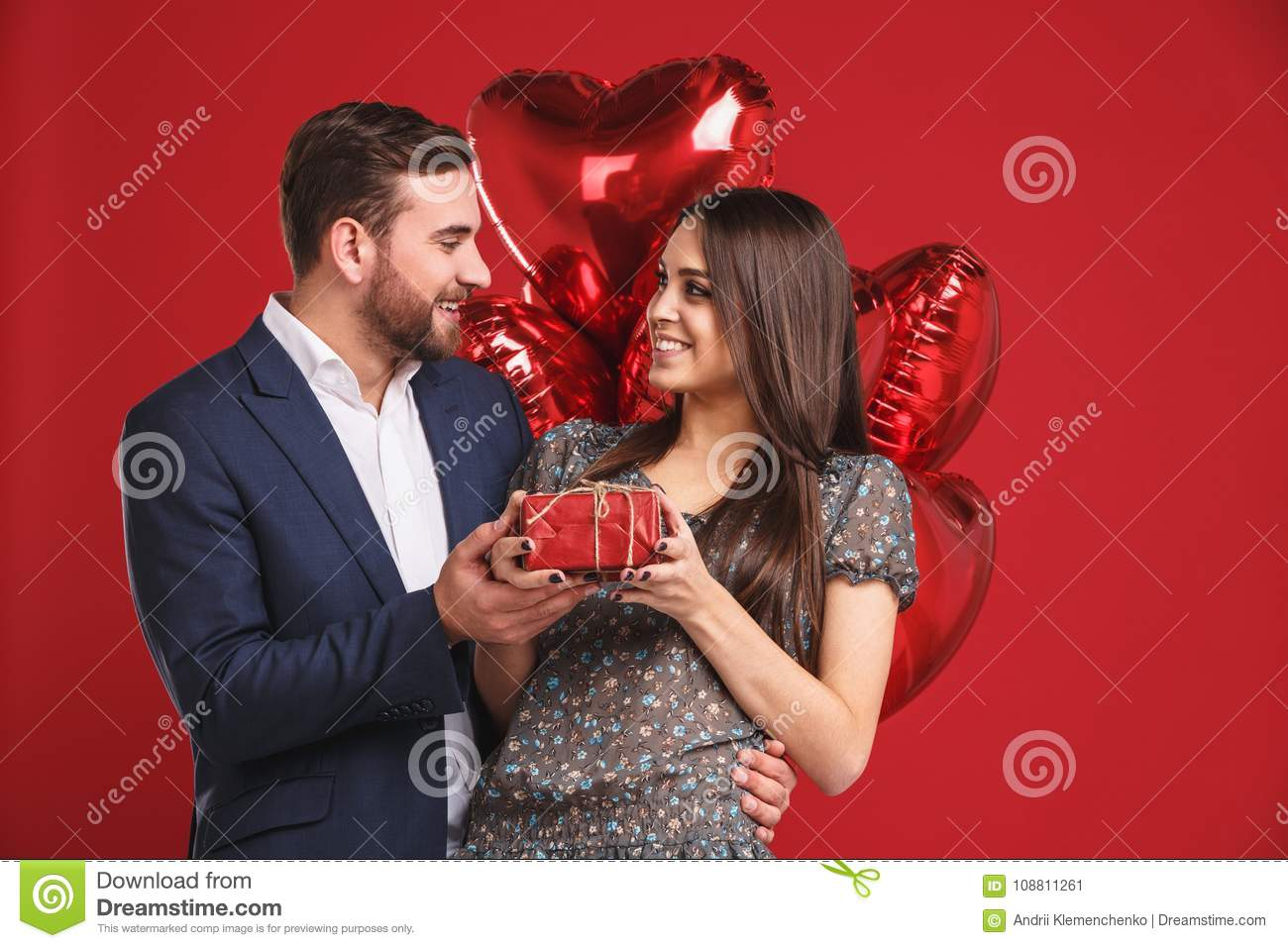 HAppy valentines day. Boy gives a gift to his girl