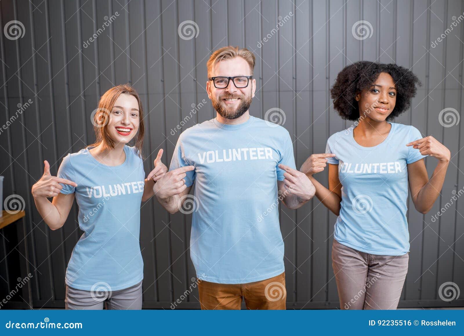 Happy volunteers indoors