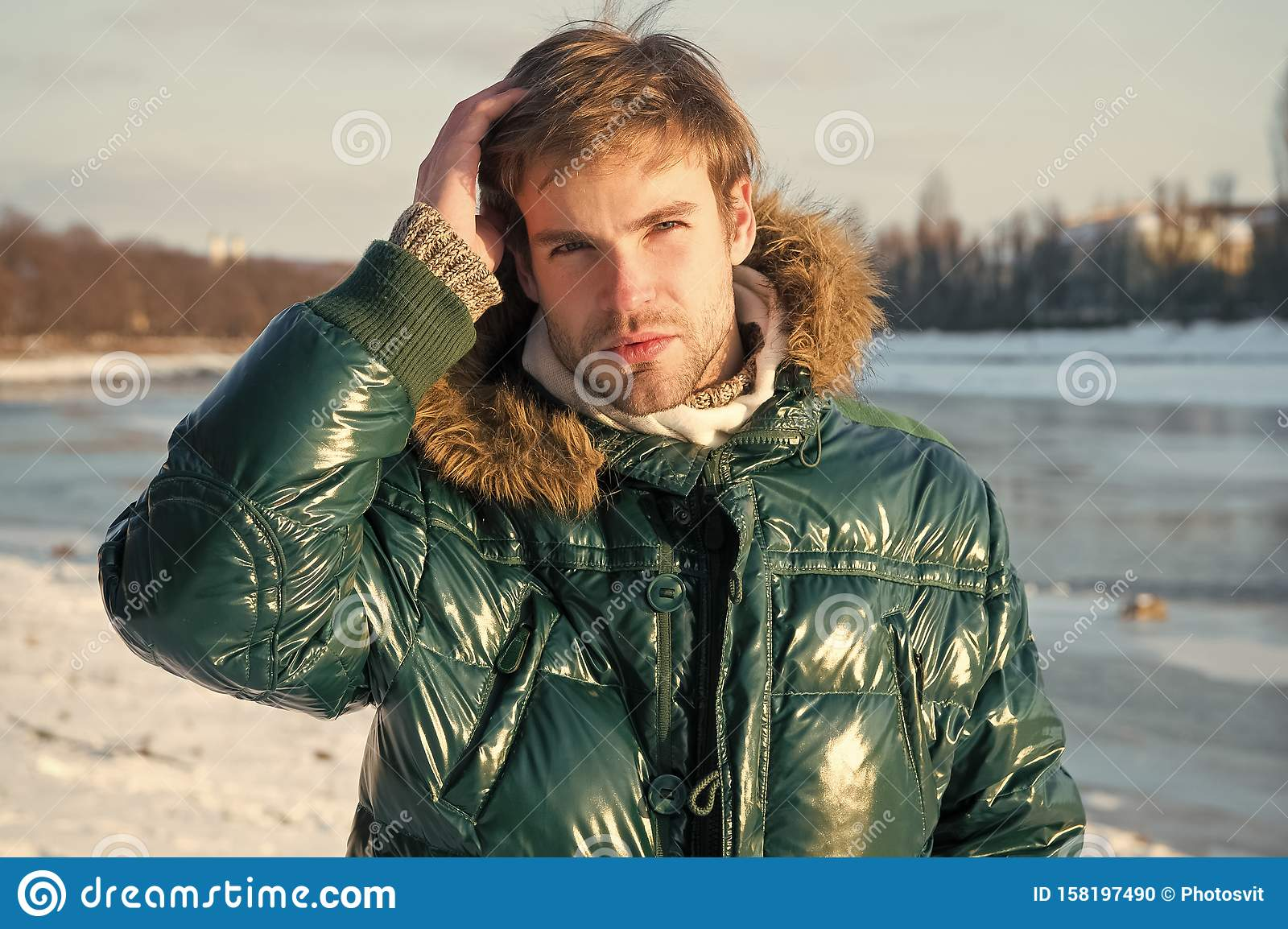 Happy winter holidays. Flu and cold. Winter fashion. Green warm coat. Warm clothes for cold season. Man traveling in