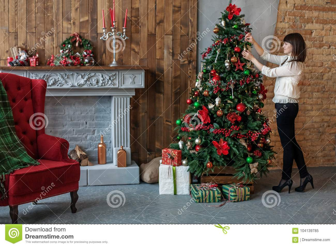 Happy Woman Adorns A Christmas Tree At Home. Concept Of Merry C ...