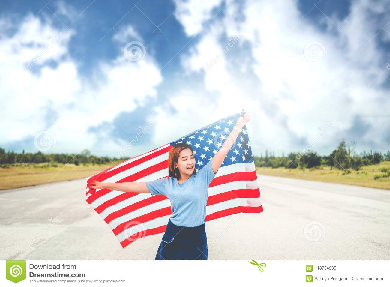 Happy woman with American flag USA celebrate 4th of July