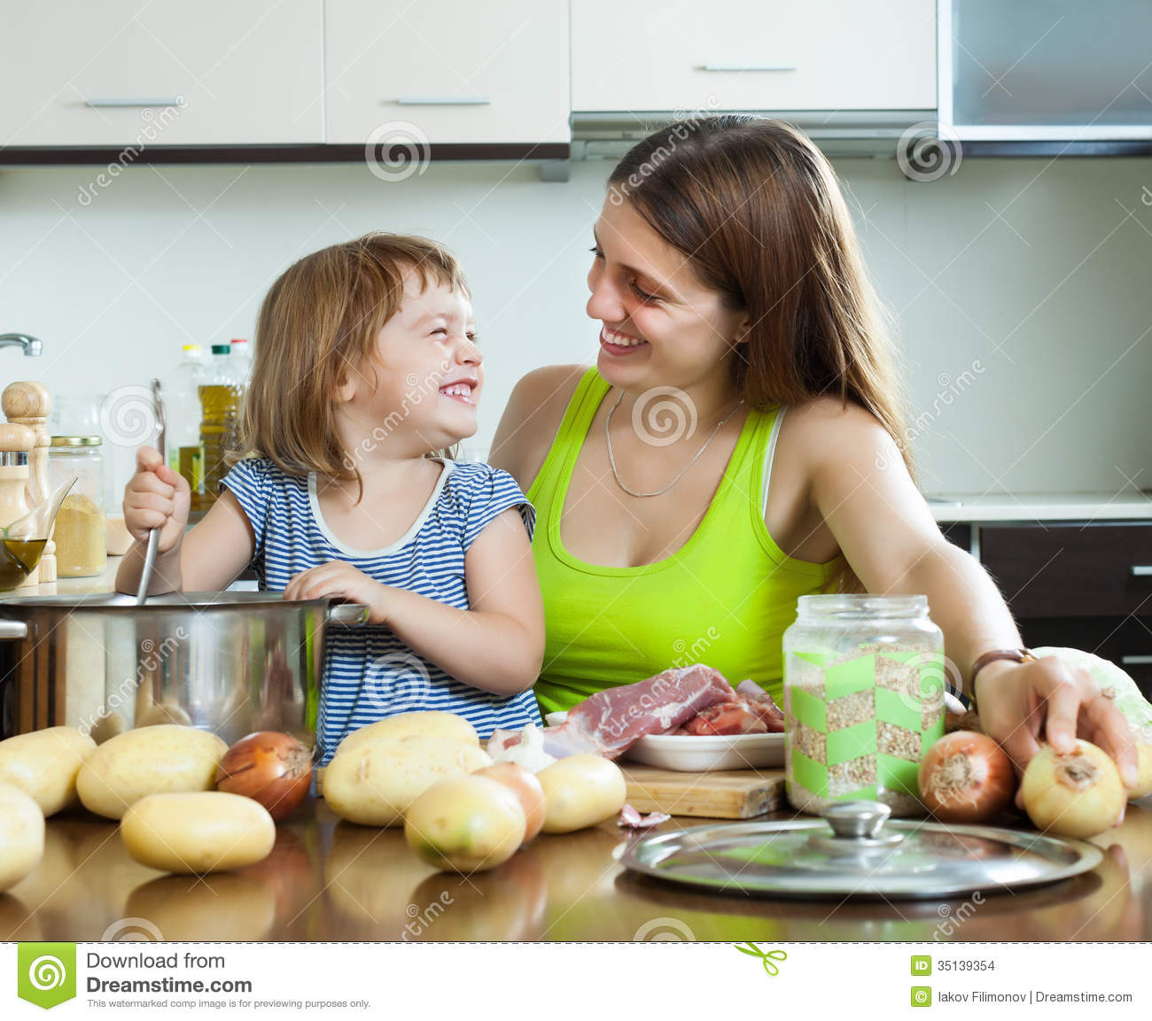 Women Kitchen: Happy Woman With Baby Cooking At Kitchen Stock Images