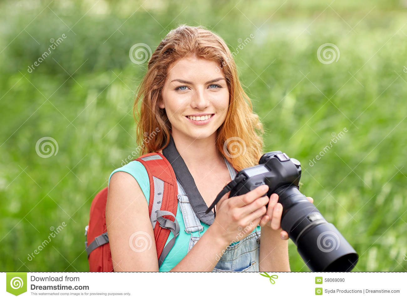 Happy Woman With Backpack And Camera Outdoors Stock Photo ...