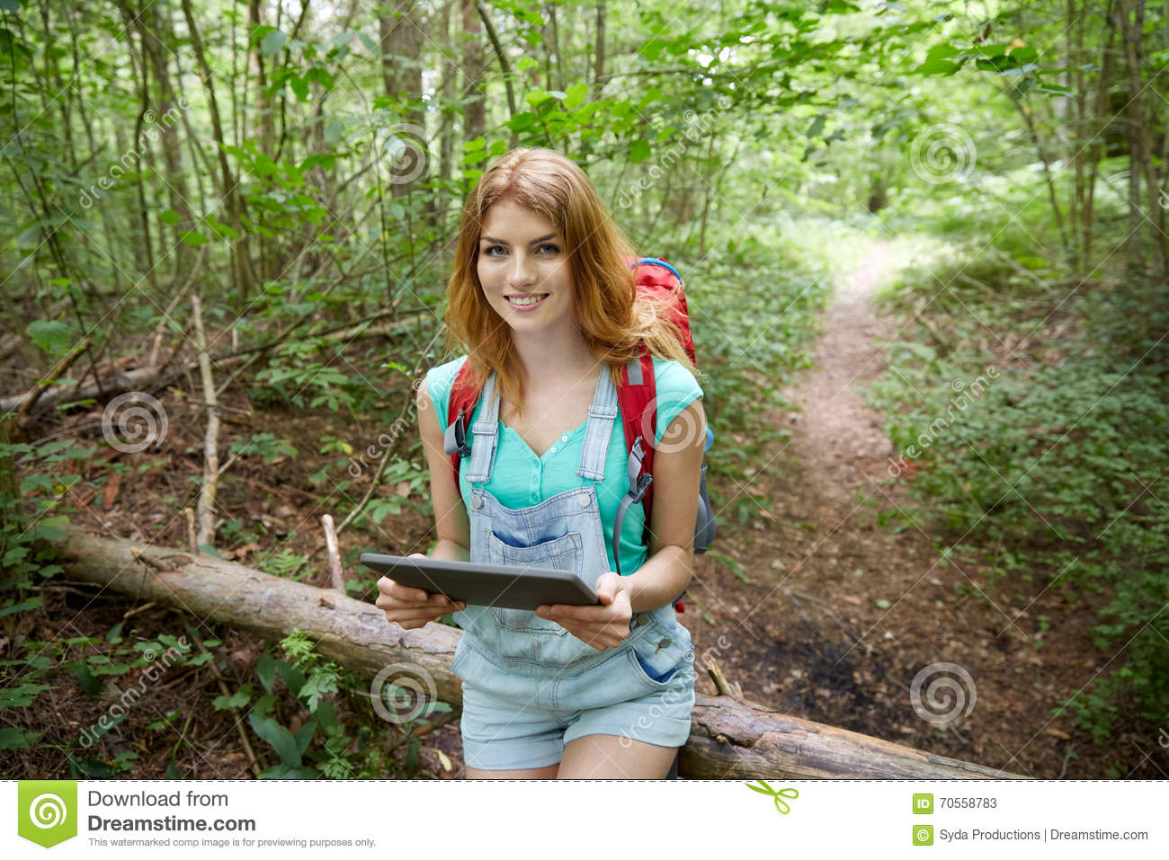Happy Woman With Backpack And Tablet Pc In Woods Stock ...