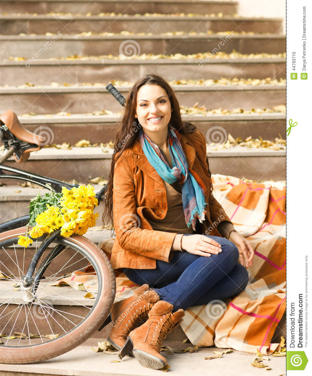 Happy woman with bike in autumn park