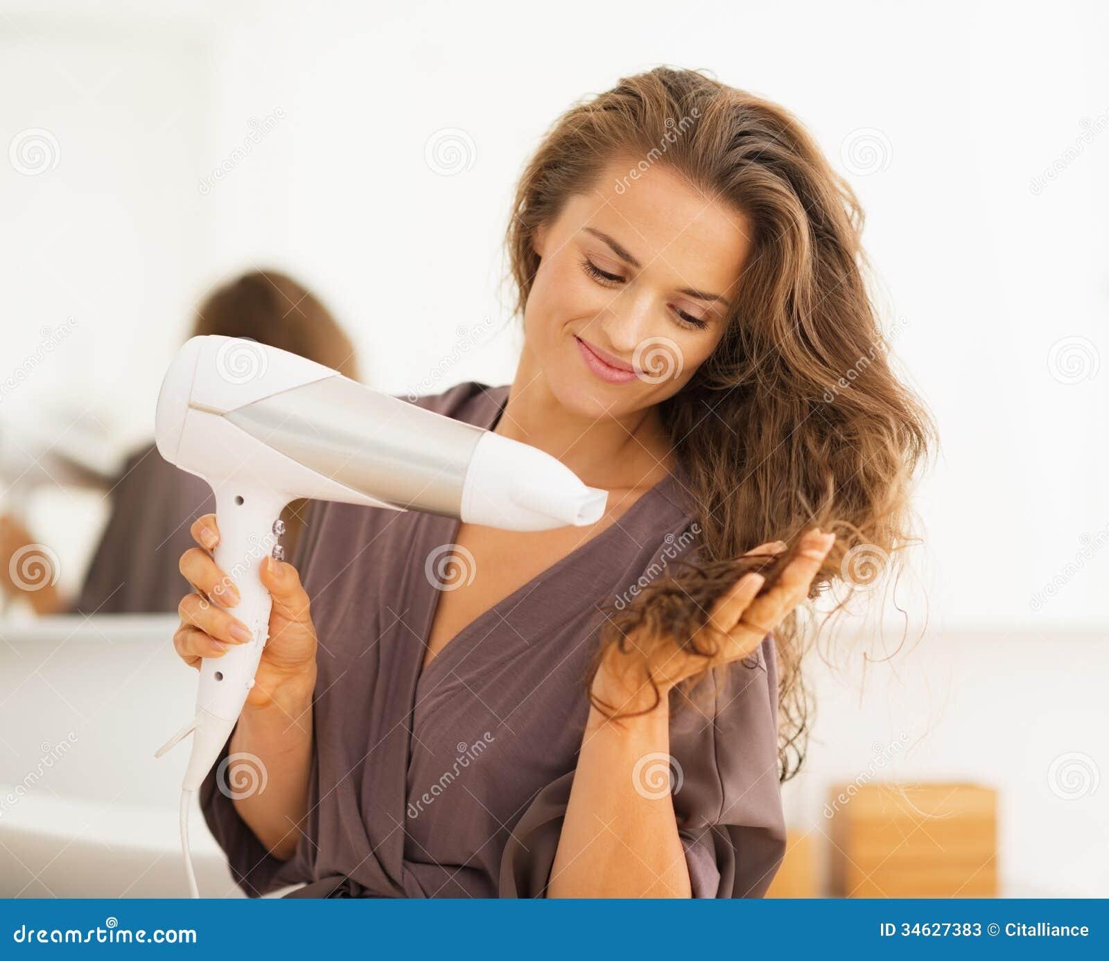 Happy Woman Blow Drying Hair In Bathroom Stock Image ...