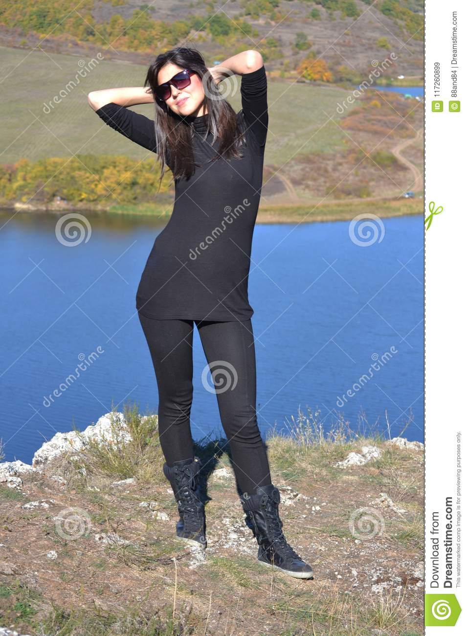 Happy Woman on a Blue Lake Background