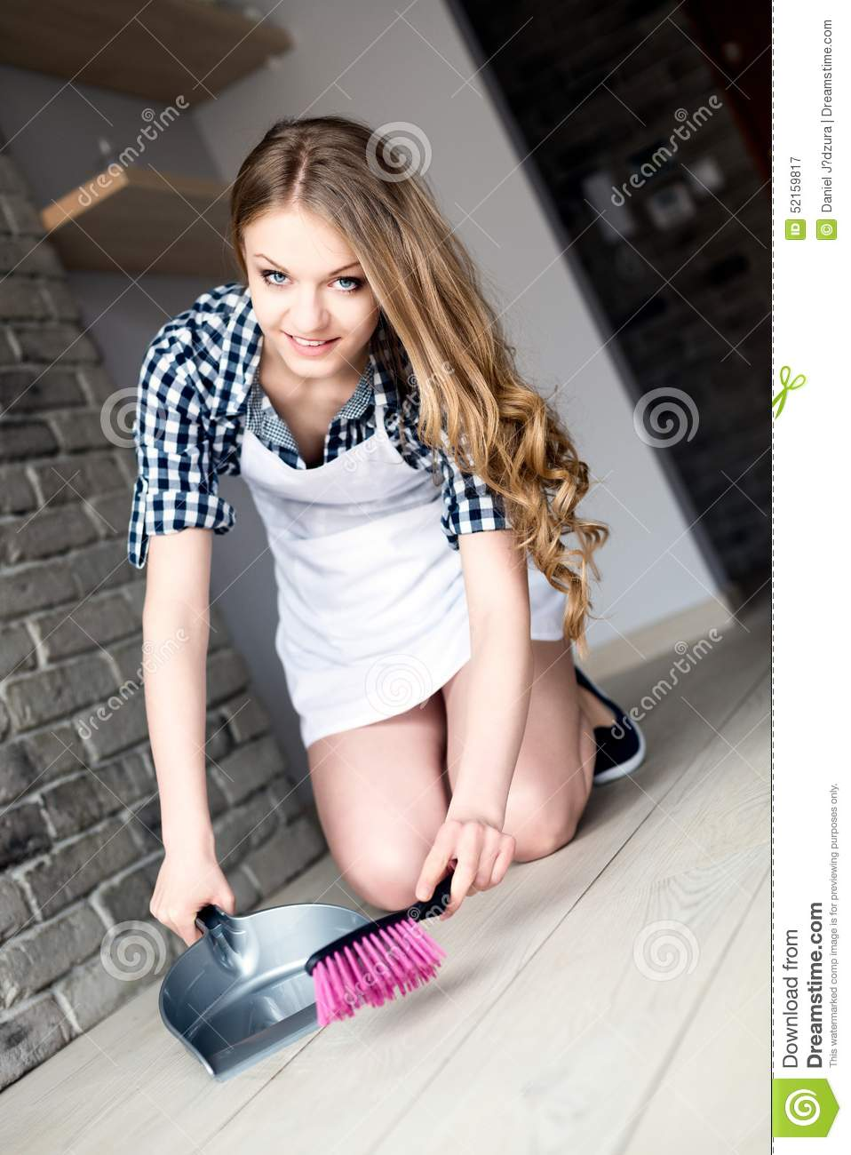 White apron girl - Happy Woman With Brush And Dustpan Floor At Home