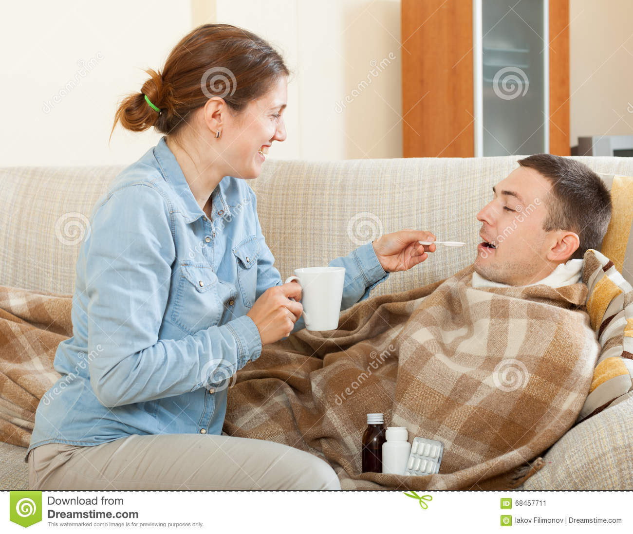 Wife Nursing Sick Husband With Cold Stock Photo