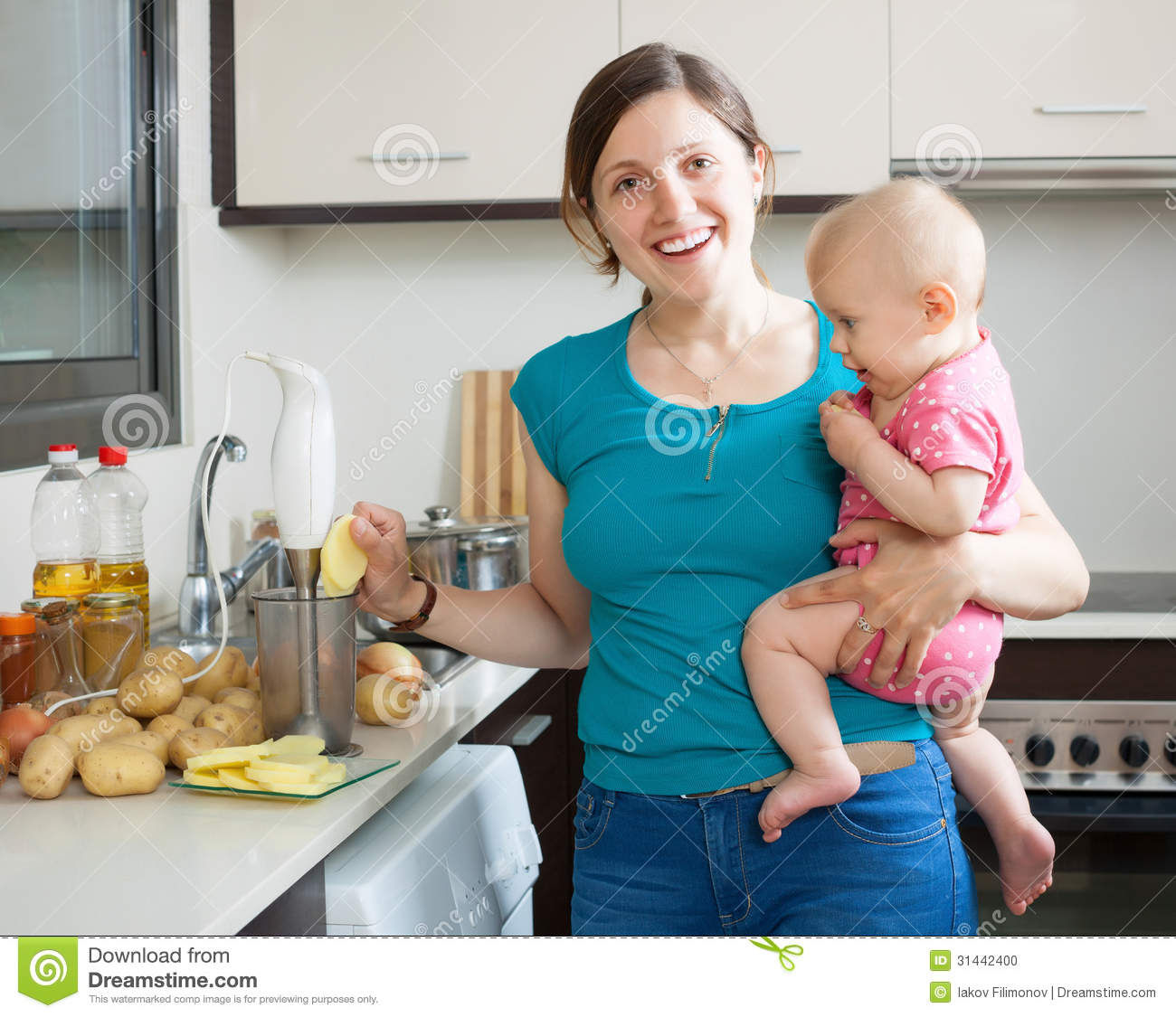 Women Kitchen: Happy Woman With Child Cooking Mashed Potatoes Stock Photo