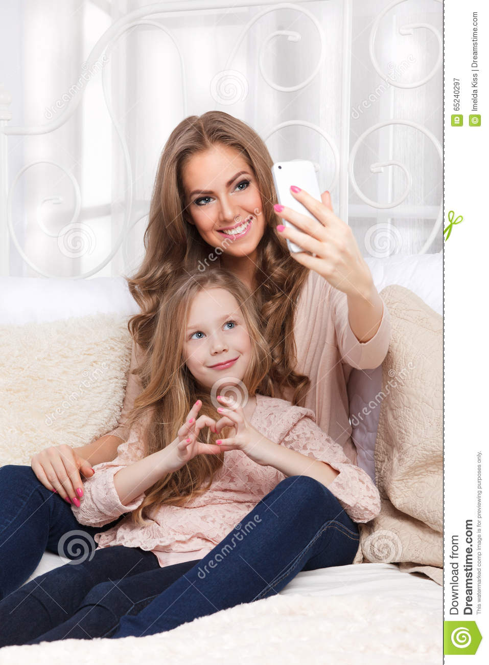 Happy woman and child taking a selfie