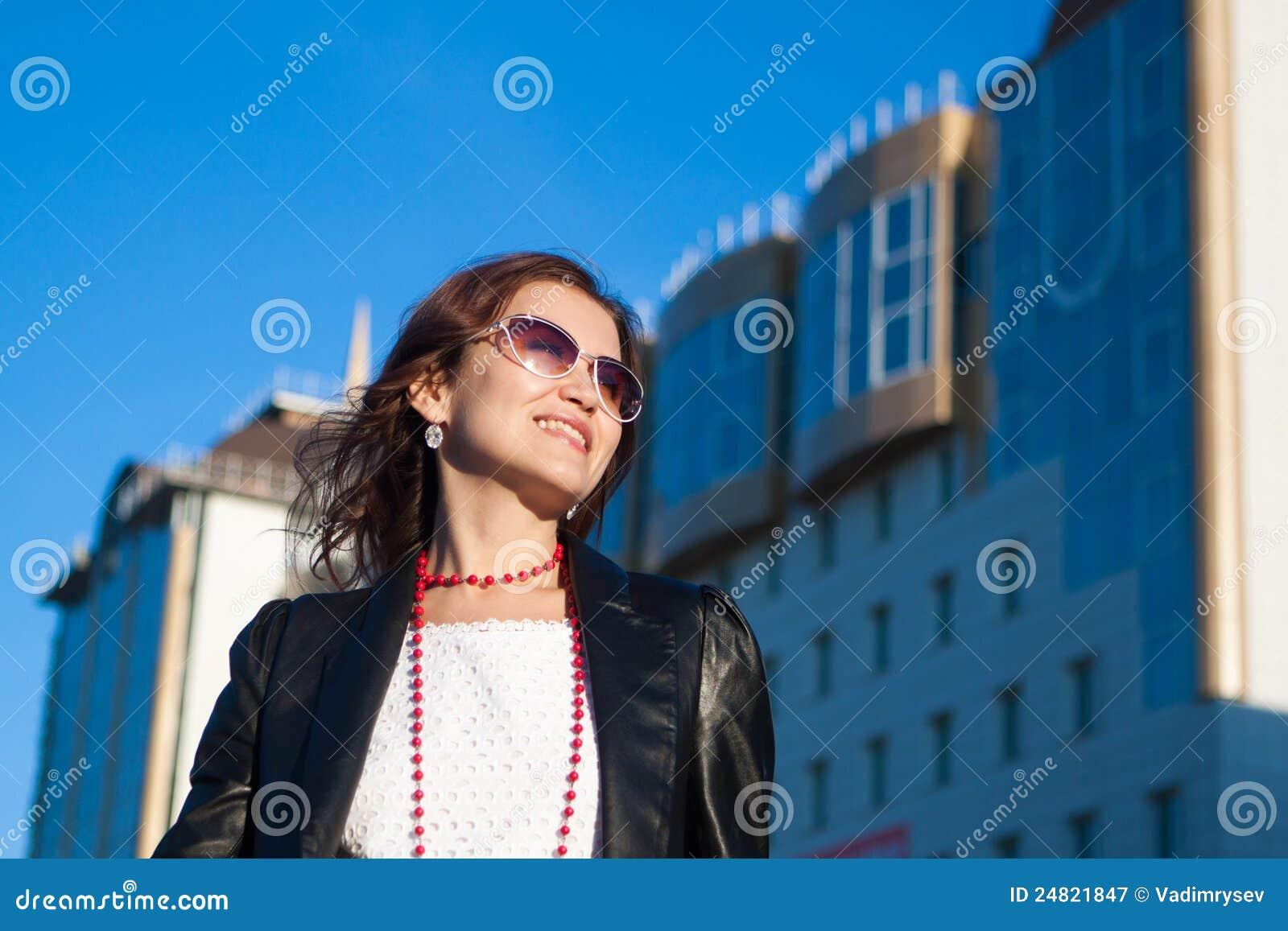 Happy woman on a city street