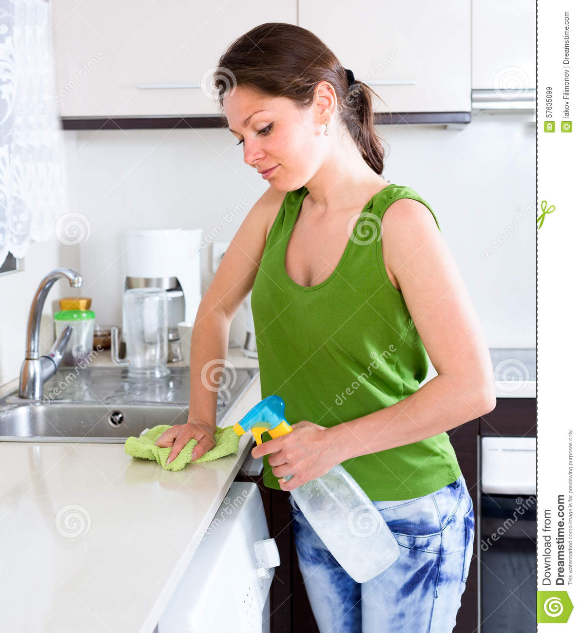 Happy Woman Cleaning Kitchen Furniture Stock Image