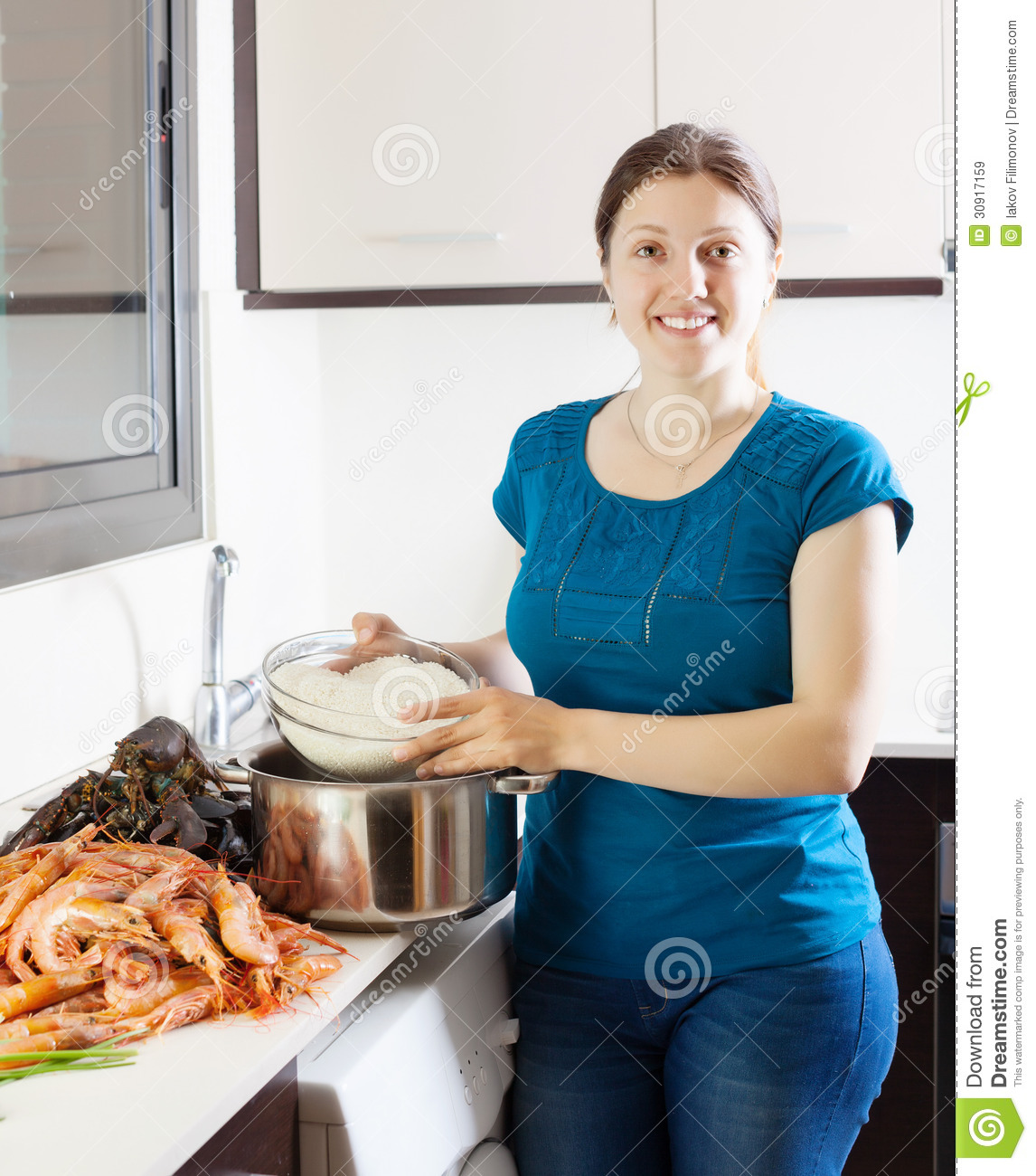 Women Kitchen: Happy Woman Cooking Paella Stock Image. Image Of Cooking