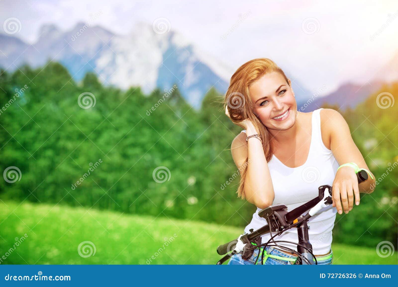 Happy woman cycling