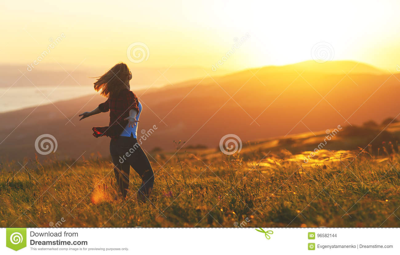 Happy Woman Dances Jump Rejoices Laughs On Sunset In Nature Stock