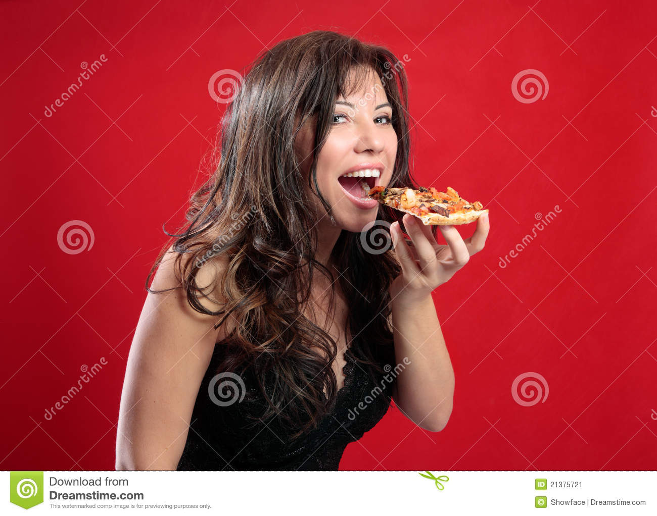 Happy woman eating pizza