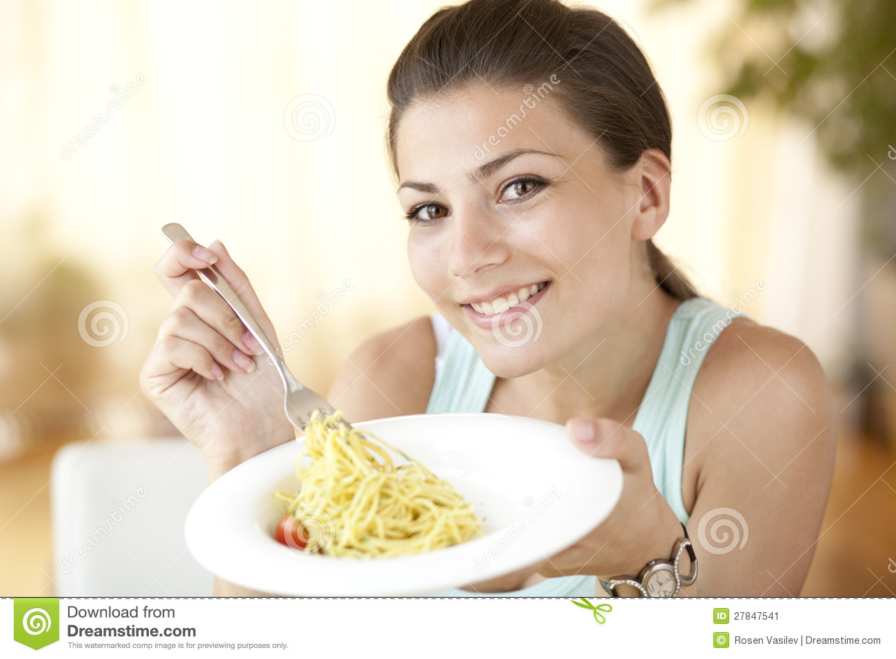 Happy woman eating spagetti