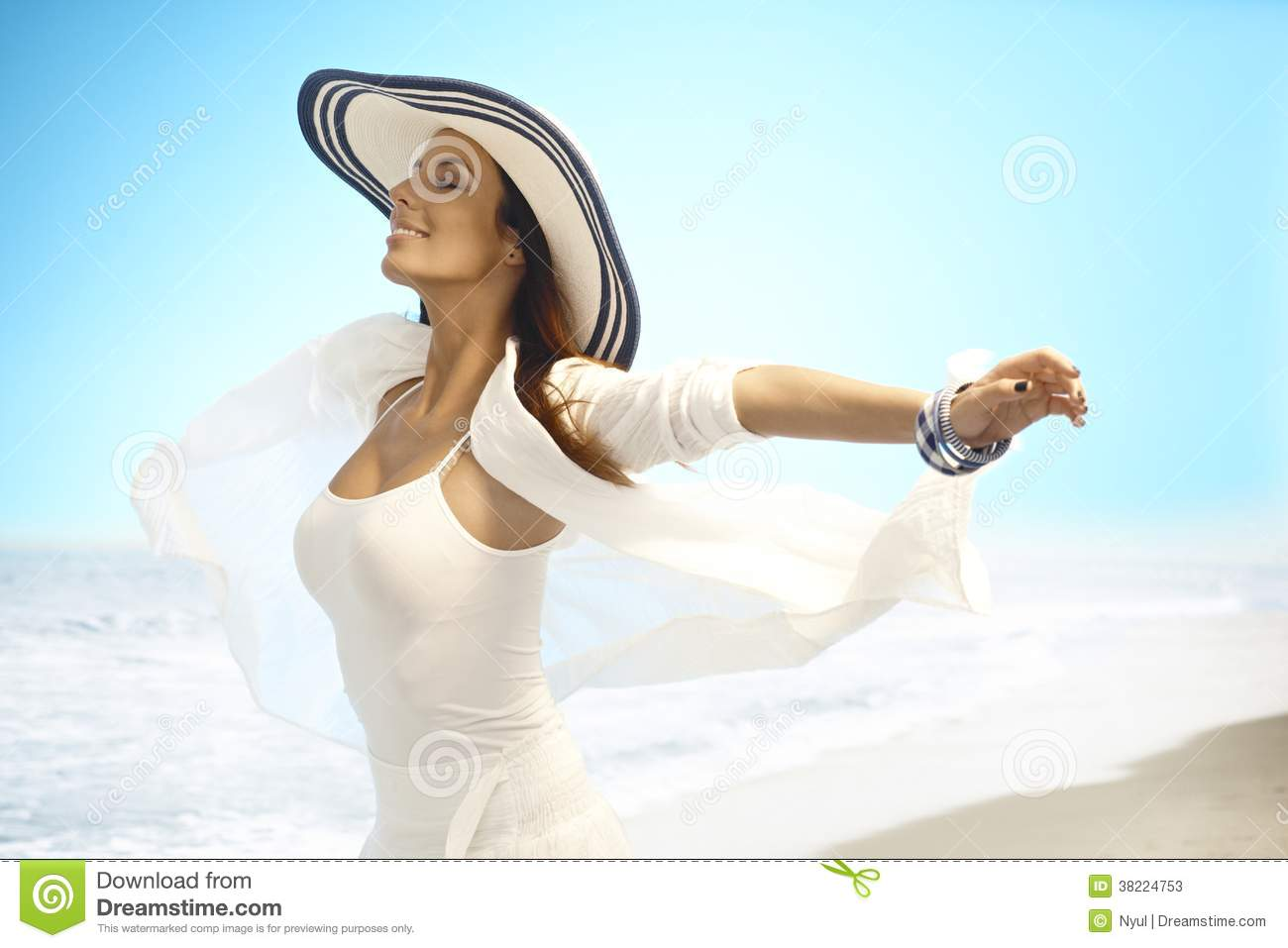 Happy woman enjoying summer sun on beach