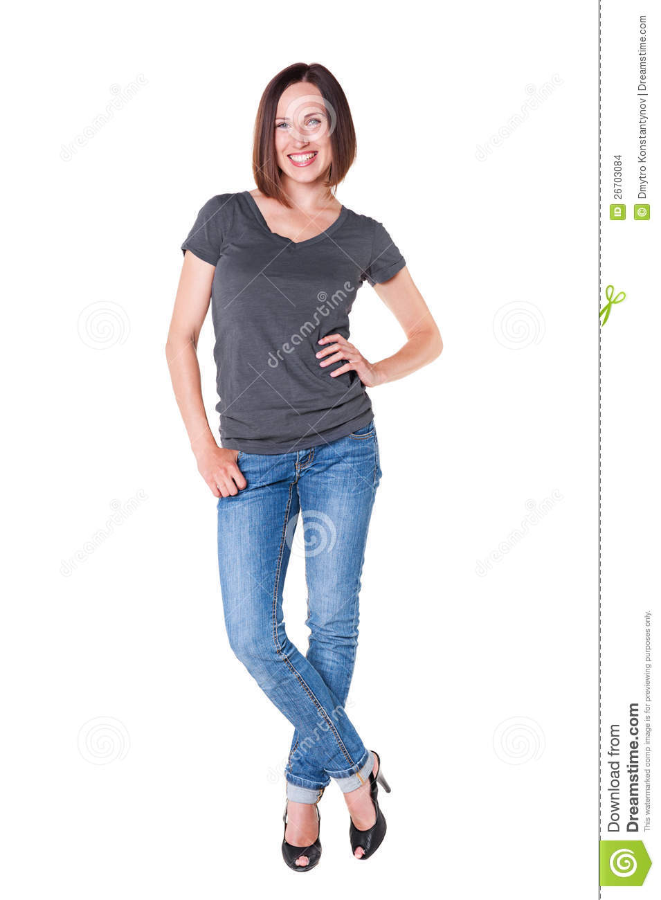happy woman in grey t shirt and blue jeans stock photo