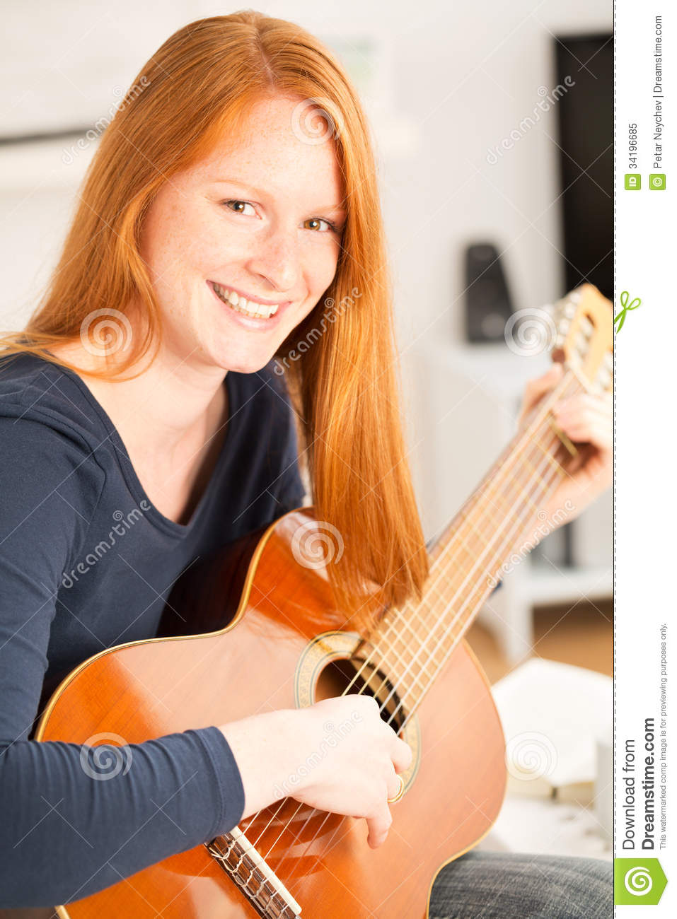 happy-woman-guitar-home-young-playing-acoustic-her-living-room-smiling-camera-34196685.jpg