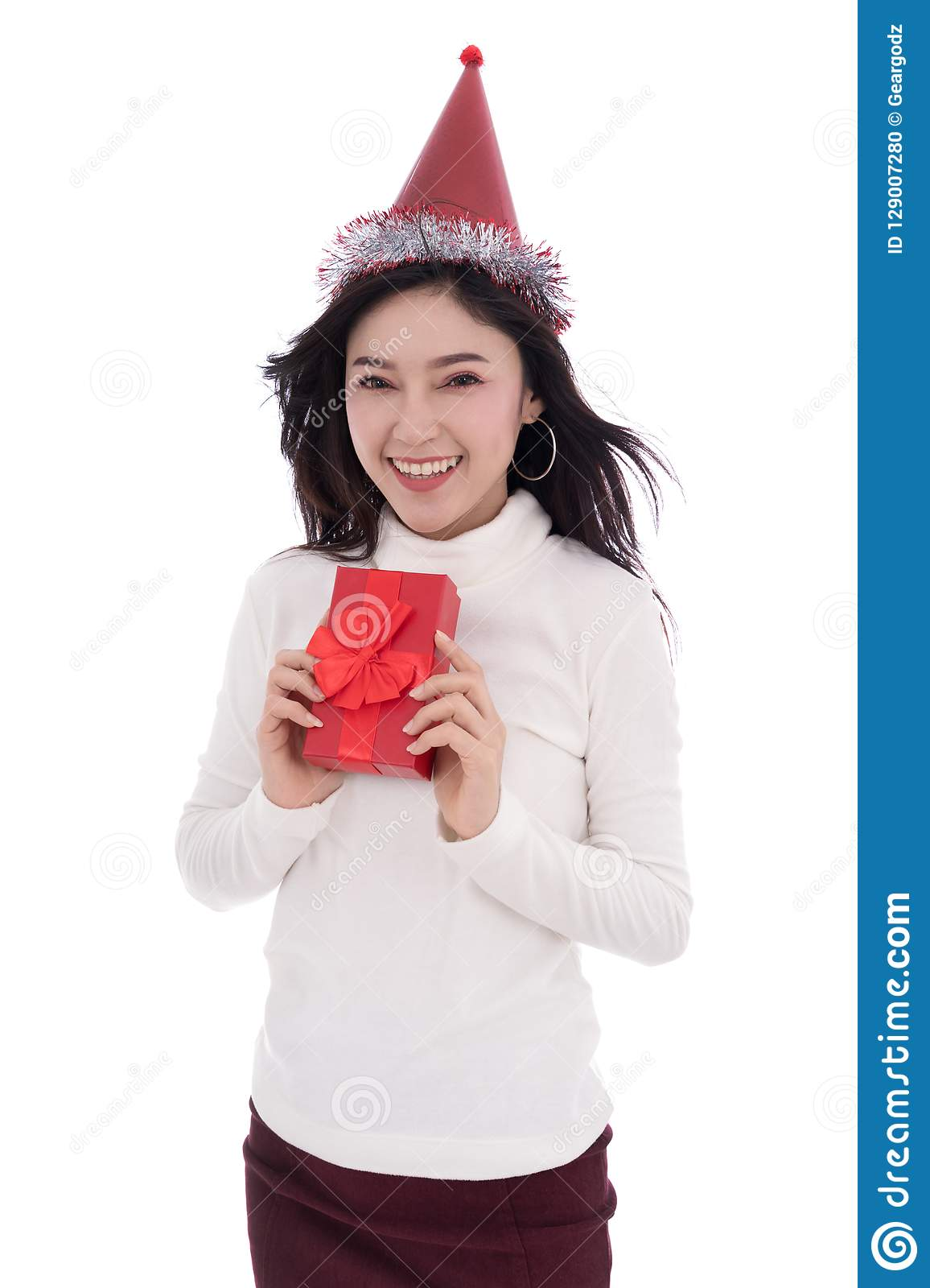 happy woman with hat and holding a red christmas gift box isolated on a white background