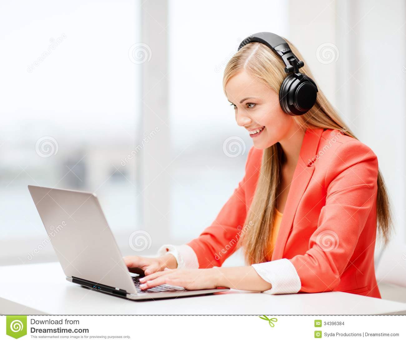 Happy Woman With Headphones Listening To Music Stock