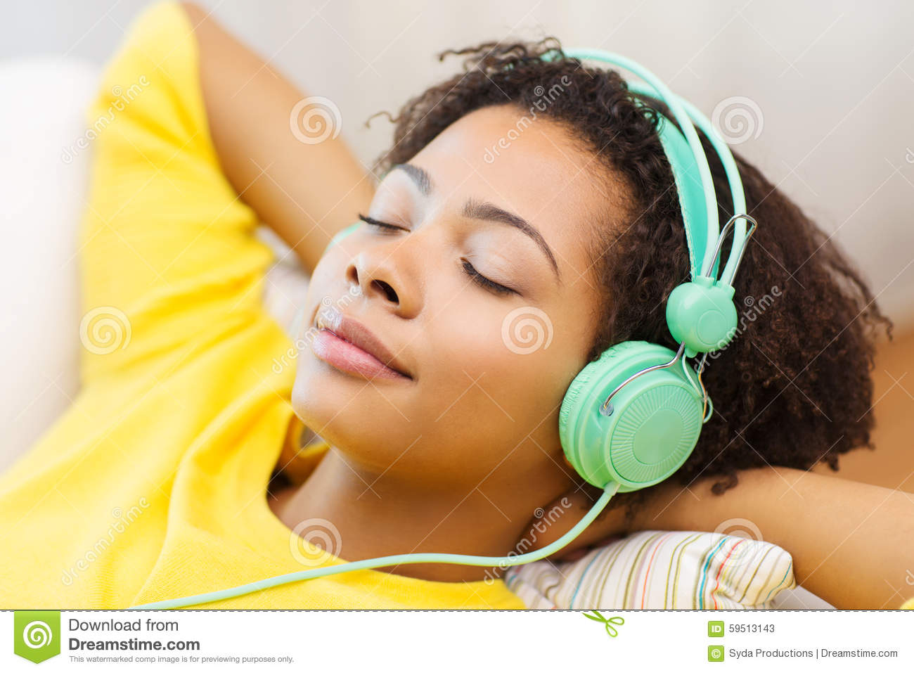 happy-woman-headphones-listening-to-music-people-technology-leisure-concept-african-american-young-sitting-sofa-59513143.jpg