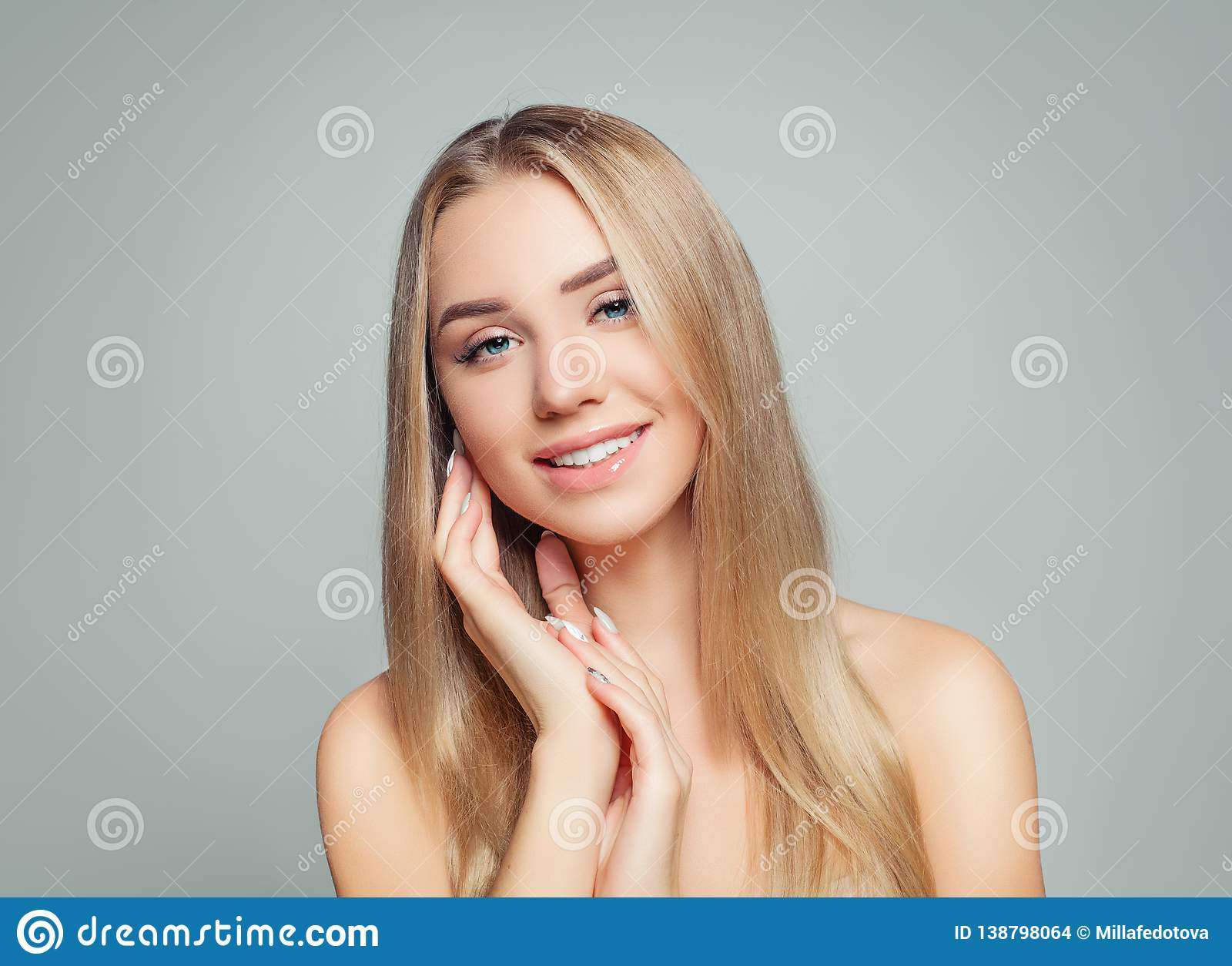 Happy woman with healthy hair and skin. Blonde girl smiling