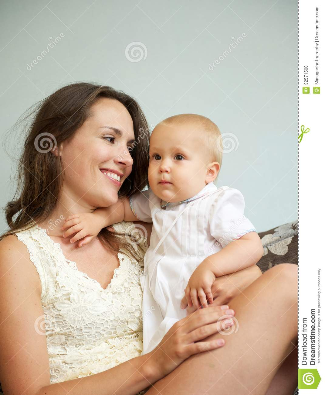 Happy Woman Holding Cute Baby Indoors Stock Photo - Image ...