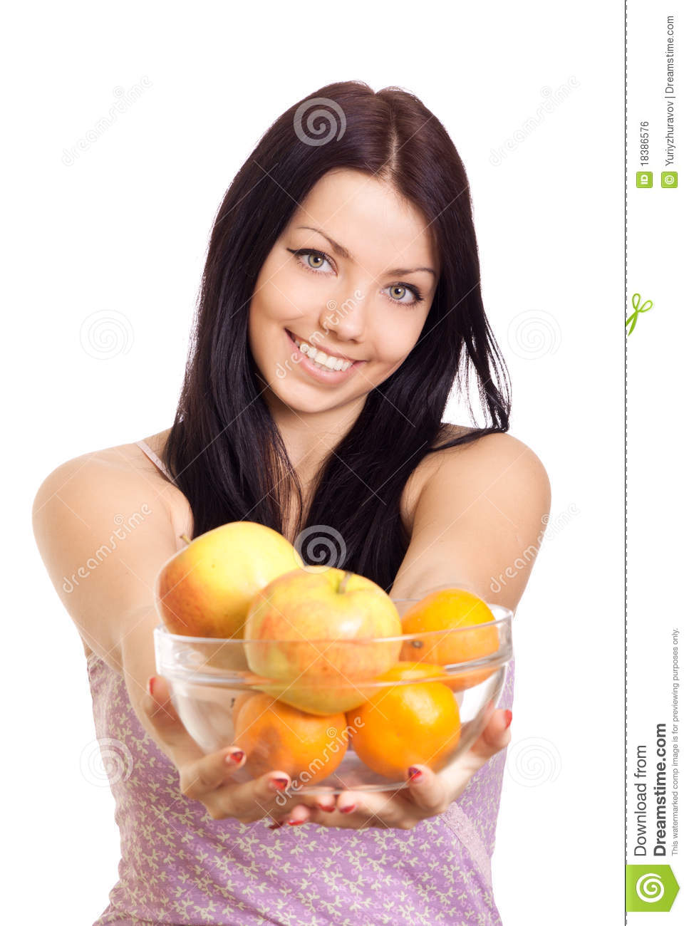 Happy woman holding a dish with fruits