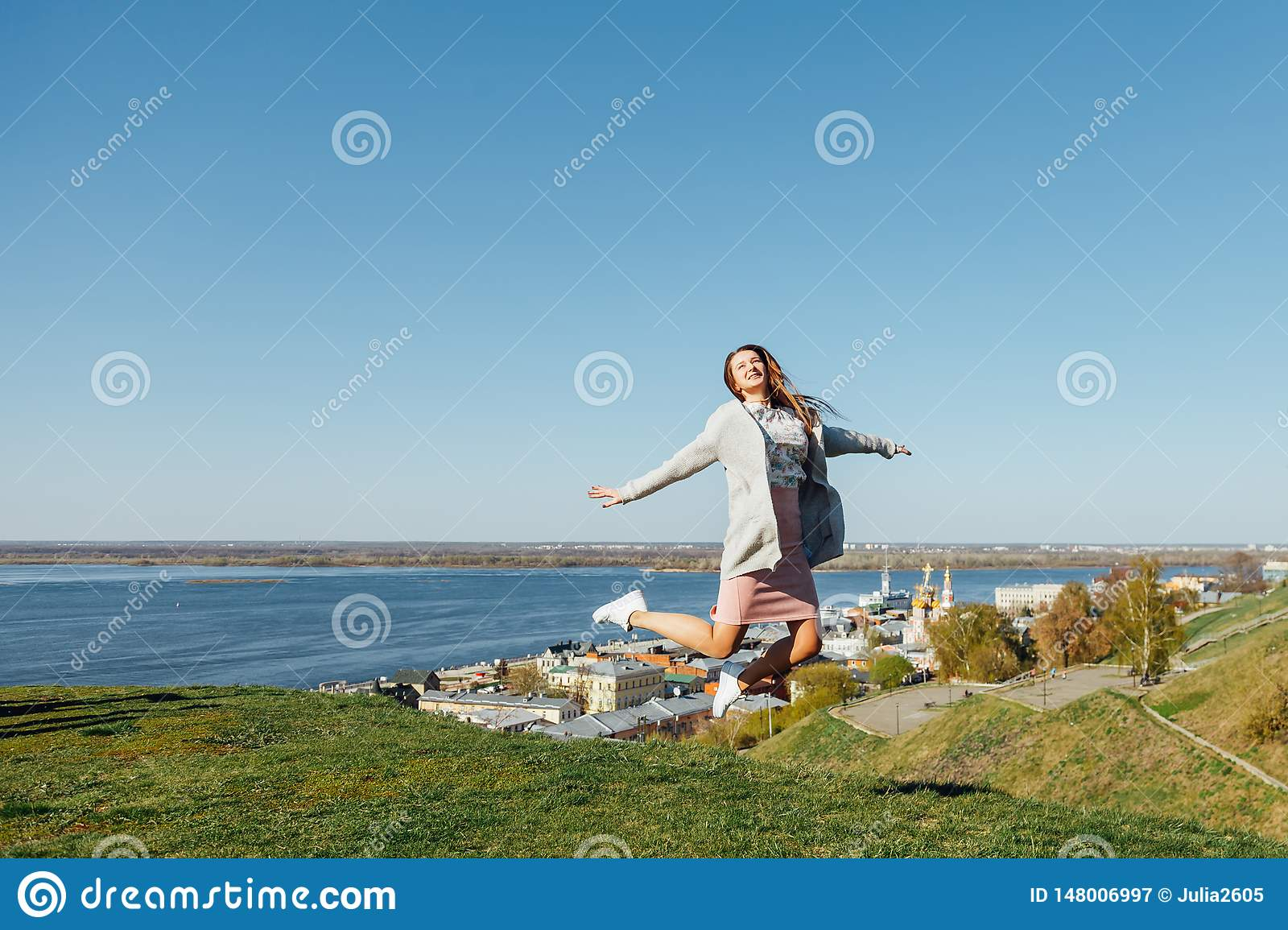 Happy woman jumping in the air
