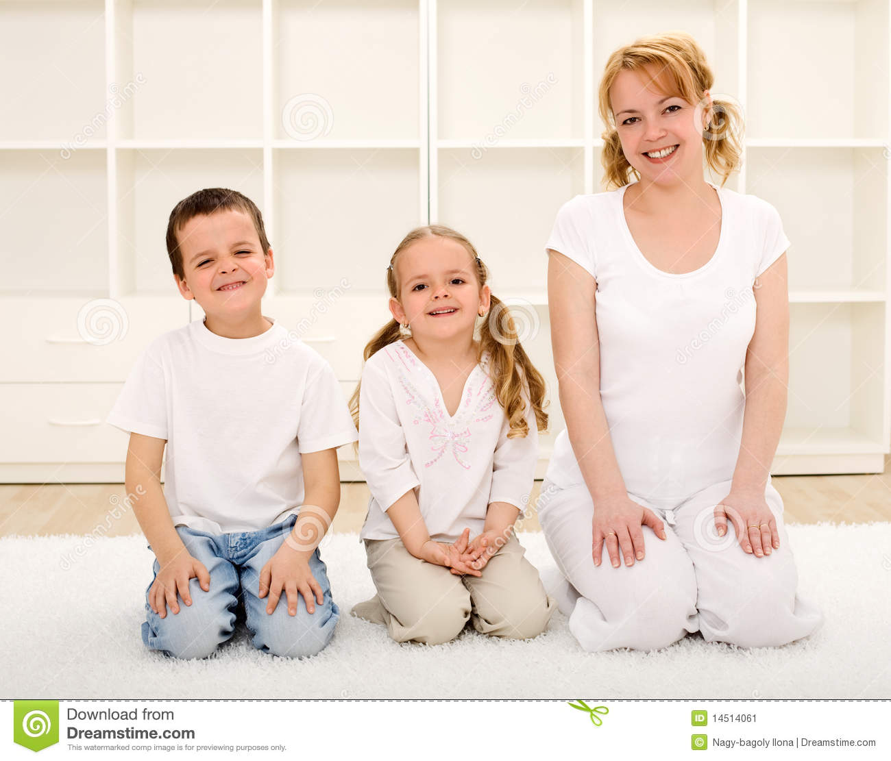Happy woman and kids indoors sitting on the floor stock for On the floor on the floor