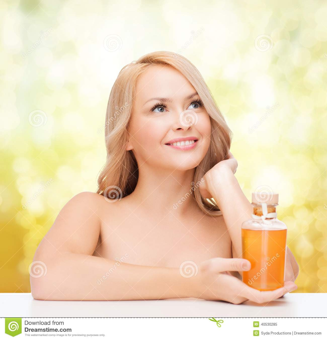 Happy Woman With Oil Bottle Royalty Free Stock Photography