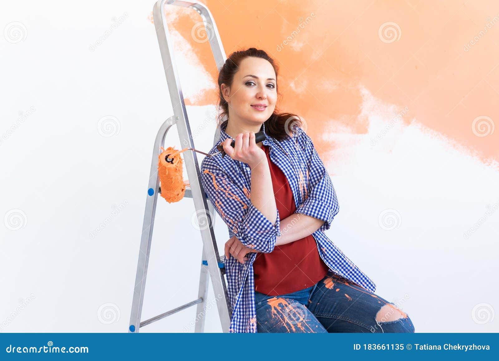 Woman Painting Interior Royalty Free Stock Photos - Image