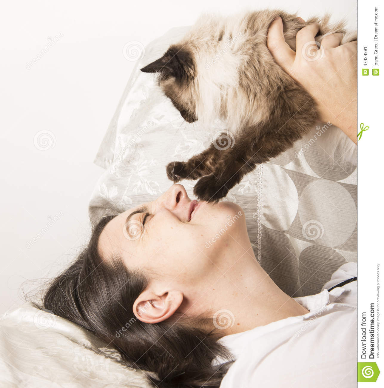 Happy woman playing with cat