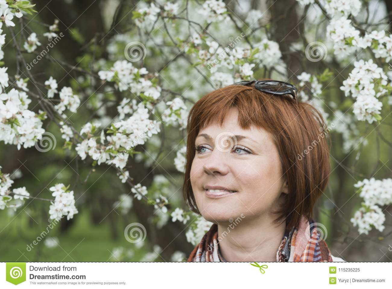 Woman in spring blossom